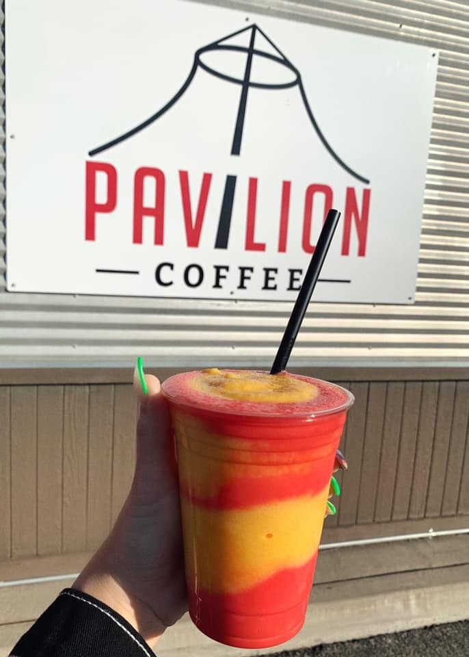 hand holding drink from Pavilion Coffee
