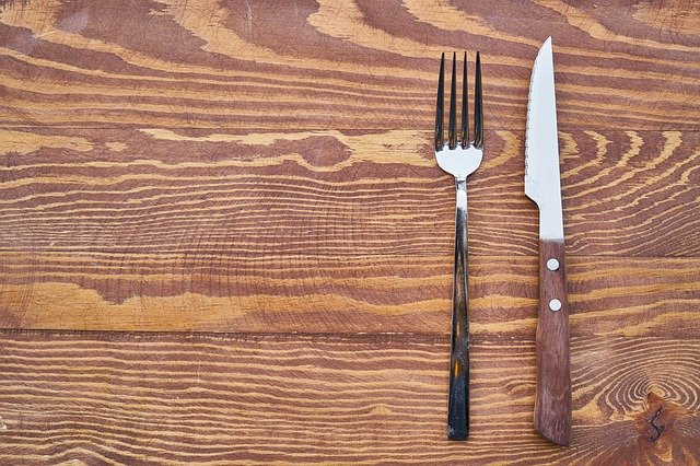 empty table with fork and knife